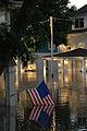Flag dipping in water on a porch in Cedar Rapids Iowa.jpg