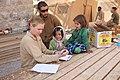 Flickr - DVIDSHUB - FET leader from Wisconsin bridges language barriers between local Afghan children, coalition forces (Image 3 of 7).jpg