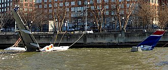 US Airways Flight 1549 - The partially submerged aircraft tied up alongside Battery Park City