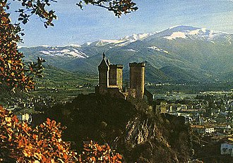 County of Foix - Castle of Foix towering above the town, with the Pyrenees behind.