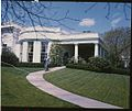 Ford walking on sidewalk between Oval Office and South Driveway 1A.jpg