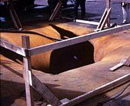 Forrestal bomb hole '67