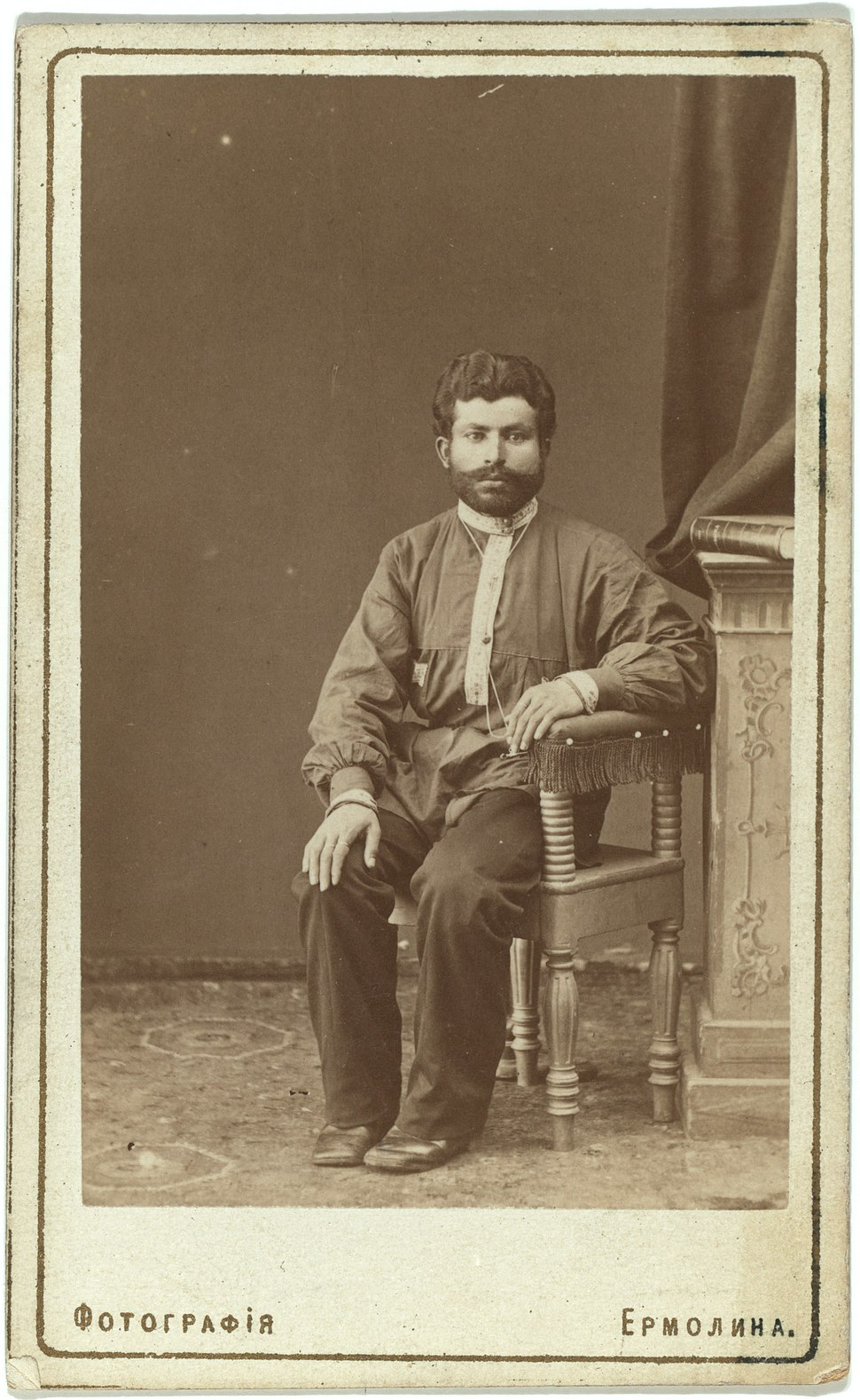 Full-length portrait of Armenian man, seated, facing front LCCN99615600