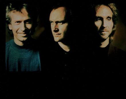 Collins with his two Genesis bandmates, Tony Banks (left) and Mike Rutherford (right) in 1991. Collins toured with Genesis the following year, his last with the band until 2007 Genesis (UK).jpg