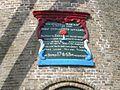 Gevelsteen met tekst boven de ingang van ronde stenen grondzeiler - AMR Molenfoto - 20540812 - RCE.jpg