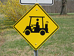 Golf cart warning sign
