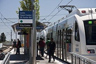 Lents Town Center/Southeast Foster Road station - Passengers disembark a Clackamas-bound train