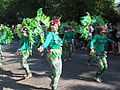 Green samba dancers from União da Roseira at Helsinki Samba Carnaval 2019.jpg