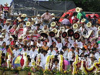Indigenous peoples of Mexico - Indigenous people from all parts of Mexican state of Oaxaca, participate wearing traditional clothes and artifacts, in a celebration known as Guelaguetza.