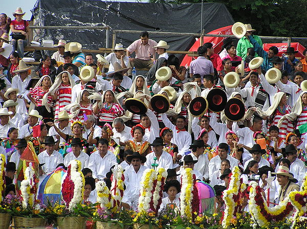 Indigenous people from all parts of Mexican state of Oaxaca, participate wearing traditional clothes and artifacts, in a celebration known as Guelaguetza. Guelaguetza01.JPG