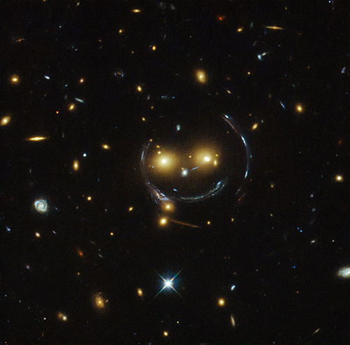 "10 February: ""Smiley"" image of galaxy cluster (SDSS J1038+4849) and gravitational lensing (an Einstein ring) (HST). HST-Smiling-GalaxyClusterSDSS-J1038+4849-20150210.jpg"