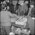 Heart Mountain Relocation Center, Heart Mountain, Wyoming. Big city newspapers on the counter of th . . . - NARA - 539200.tif