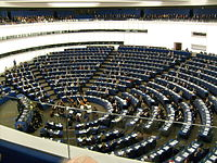 Hemicycle of European Parliament, Strasbourg, with chamber orchestra performing.jpg