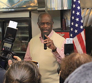 Herman Cain presidential campaign, 2012 - Herman Cain explains his economic plan to supporters at a campaign event at a diner in Ypsilanti, Michigan, November 10, 2011.