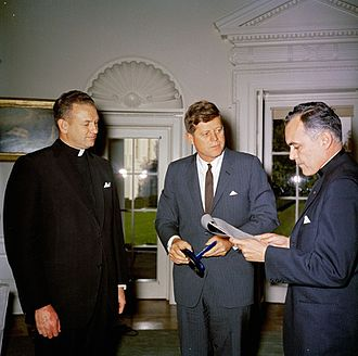 Laetare Medal - Rev. Hesburgh presents the 1961 Laetare Medal to President John F. Kennedy. Fr Edmund P. Joyce to the side.