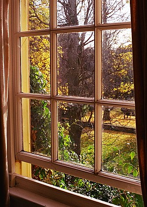 Holywell Manor, Oxford - View through a window in the Manor of the gardens.