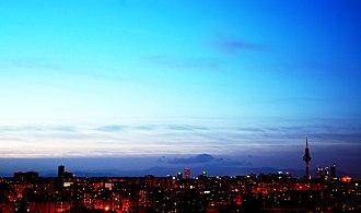 "La Movida Madrileña - Madrid near twilight. The Movida people coined the now famous war-cries of the city: ""Madrid nunca duerme"" (""Madrid never sleeps""), ""Esta noche todo el mundo a la calle"" (""Tonight everybody to the street"") or ""Madrid me mata"" (""Madrid kills me"")."