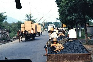 History of transport in China - Horse-drawn conveyances bearing goods and coal on a road in China, 1987.