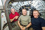 ISS-47 Jeff Williams, Tim Kopra and Tim Peake in front of BEAM's entrance.jpg