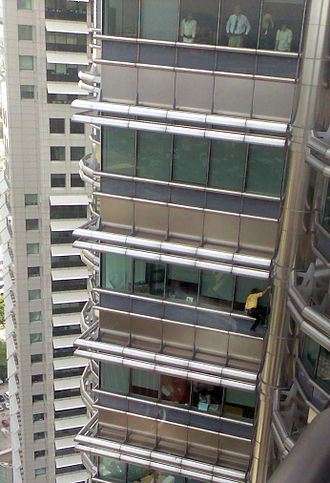 Buildering - Alain Robert climbing Petronas Tower 2 in March 2007. On this occasion, he was arrested at the 60th floor.