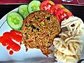 Indonesian fried rice with sliced cucumbers, tomatoes, and crackers; July 2012.jpg
