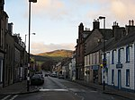 Innerleithen Sunlit hills above the High Street/A72