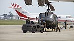 JGSDF UH-1J(41839) towed by 2t class aircraft towing tractor(TOYOTA L&F 2TG20) at JMSDF Tokushima Air Base September 30, 2017 03.jpg