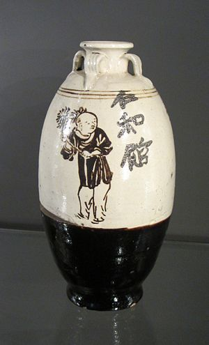 "Cizhou ware - Jin dynasty, iron-pigmented brown slip and cream slip wine bottle with painted boys, inscribed ""Benevolence and Harmony Tavern""."