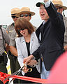 Jo-Ellen Darcy, center, the assistant secretary of the Army for Civil Works and Secretary of the Interior Ken Salazar, right, cut a ribbon on the bridge deck as part of the Tamiami Trail one-mile bridge opening 130319-A-IO255-014.jpg
