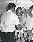 John Glenn with technicians.jpg
