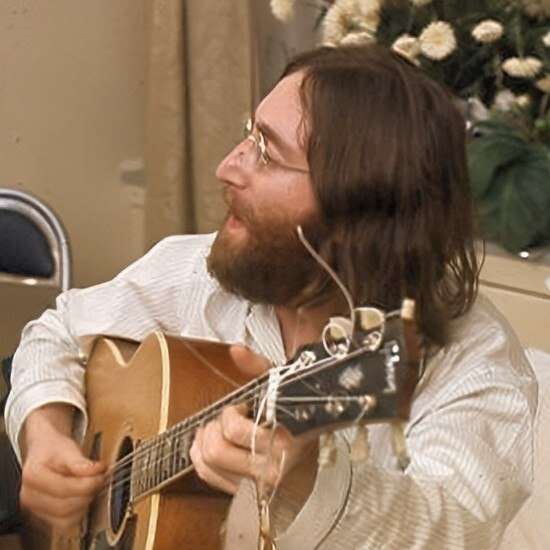 John Lennon playing guitar