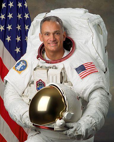 Astronaut John Olivas, NASA photo (18 September 2006) Source: Wikipedia (spaceflight.nasa.gov killed 25 Feb 2021) 384px-John_Olivas_v2.jpg