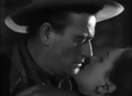 John Wayne and Ella Raines in Tall in the Saddle.png