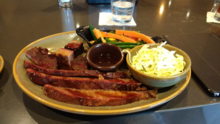 Kansas City-style Angus beef brisket and burnt ends dinner from the Q39 restaurant