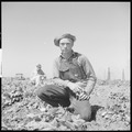 Kern County, California. Migrant youth in potato field. Waiting for the potato digger to come around again. This... - NARA - 532143.tif