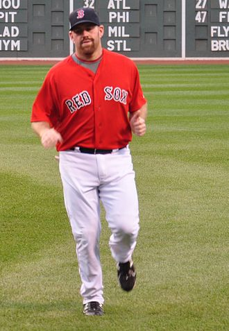 Logos and uniforms of the Boston Red Sox - Kevin Youkilis wearing the Friday Red Sox home uniforms.