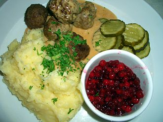 Swedish cuisine - Swedish meatballs with cream sauce, mashed potatoes, pickled cucumber, and lingonberry jam
