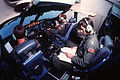 Lt. Col. Elmer Whittier Jr., left, Maj. Colin McDonald, center, and Capt. Clyde Pritchard of the 337th Military Airlift Squadron, U.S. Air Force Reserve, man their stations in the cockpit of a 60th Military DF-ST-92-01346.jpg