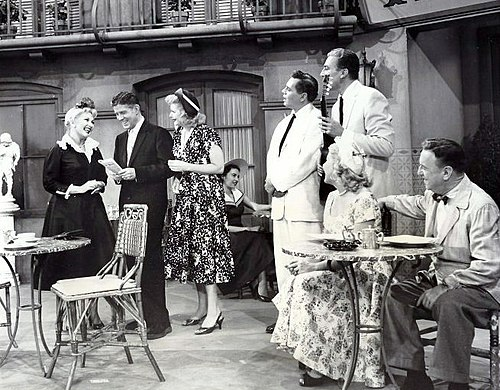 "Guest starring as ""Susie McNamara"" on The Lucy-Desi Comedy Hour, ""Lucy Takes a Cruise to Havana"", L-R: Ann Sothern, Rudy Vallee, Lucille Ball, Desi Arnaz, Cesar Romero, Vivian Vance and William Frawley (1957) Lucy Goes To Havana Lucy Desi Comedy Hour 1957.JPG"