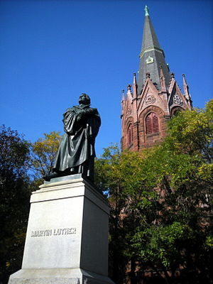 Luther Place Memorial Church - A bronze statue of Martin Luther and the Gothic Revival tower of Luther Place Memorial Church