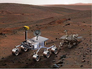 Conceptual drawing of the Mars Science Laboratory in operation on Mars, and size comparison to Mars Exploration Rover, updated version