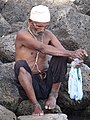Man Washes Clothes by Shore of Lake Tana - Bahir Dar - Ethiopia (8680667476).jpg
