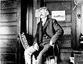 Man seated in front door of house, probably Yakutat, Alaska, circa 1906 (AL+CA 7611).jpg