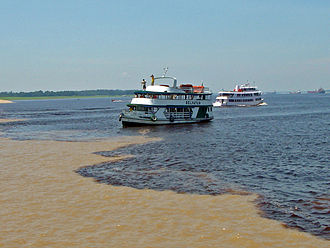 Solimões River - Solimões river at the confluence or the Meeting of Waters with Negro River, near Manaus.