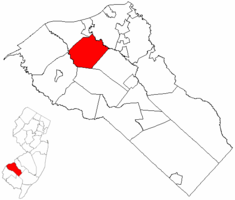 East Greenwich Township highlighted in Gloucester County. Inset map: Gloucester County highlighted in the State of New Jersey.
