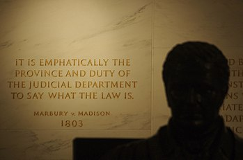 Inscription on the wall of the Supreme Court Building from Marbury v. Madison, in which Chief Justice John Marshall (statue, foreground) outlined the concept of judicial review.