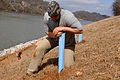 Matthew Granstaff, a biologist with the Nashville District of the U.S. Army Corps of Engineers, plants saplings as part of a riverbank stabilization project at Moccasin Bend on the Tennessee River 120227-A-EO110-006.jpg