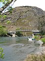 Matukituki River flows under the West Wanaka bridge before emptying into Lake Wanaka.jpg