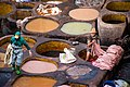 Men dyeing leather in the the old town of Fès, Morocco.jpg