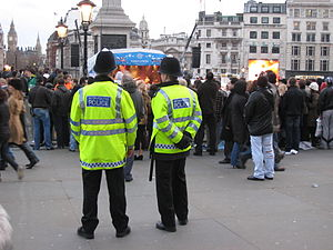 Metropolitan Police Service - Two Metropolitan Police officers overseeing an event at Trafalgar Square.